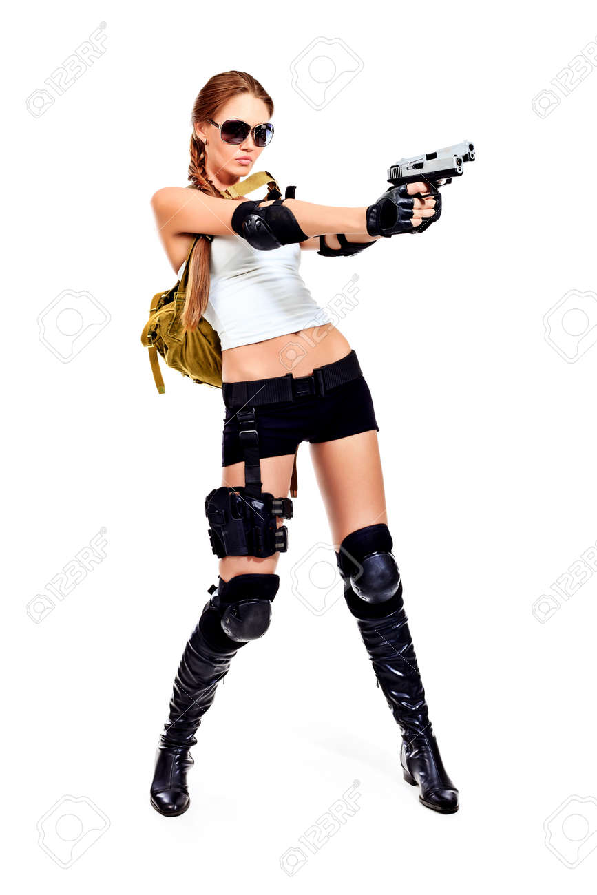 Shot of a sexy military woman posing with guns. Isolated over white. Stock Photo - 10213078