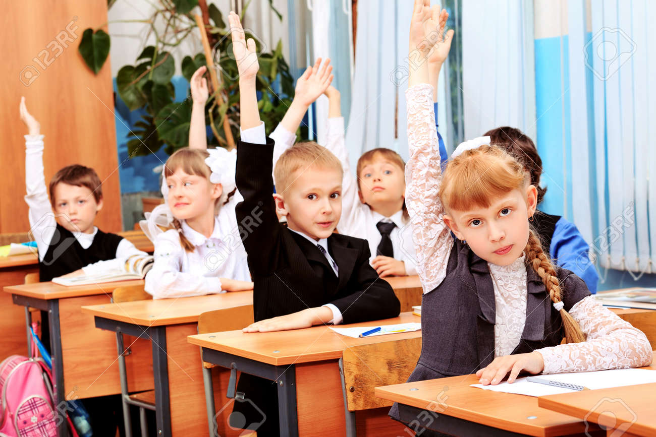 children at school during the lesson stock photo picture and