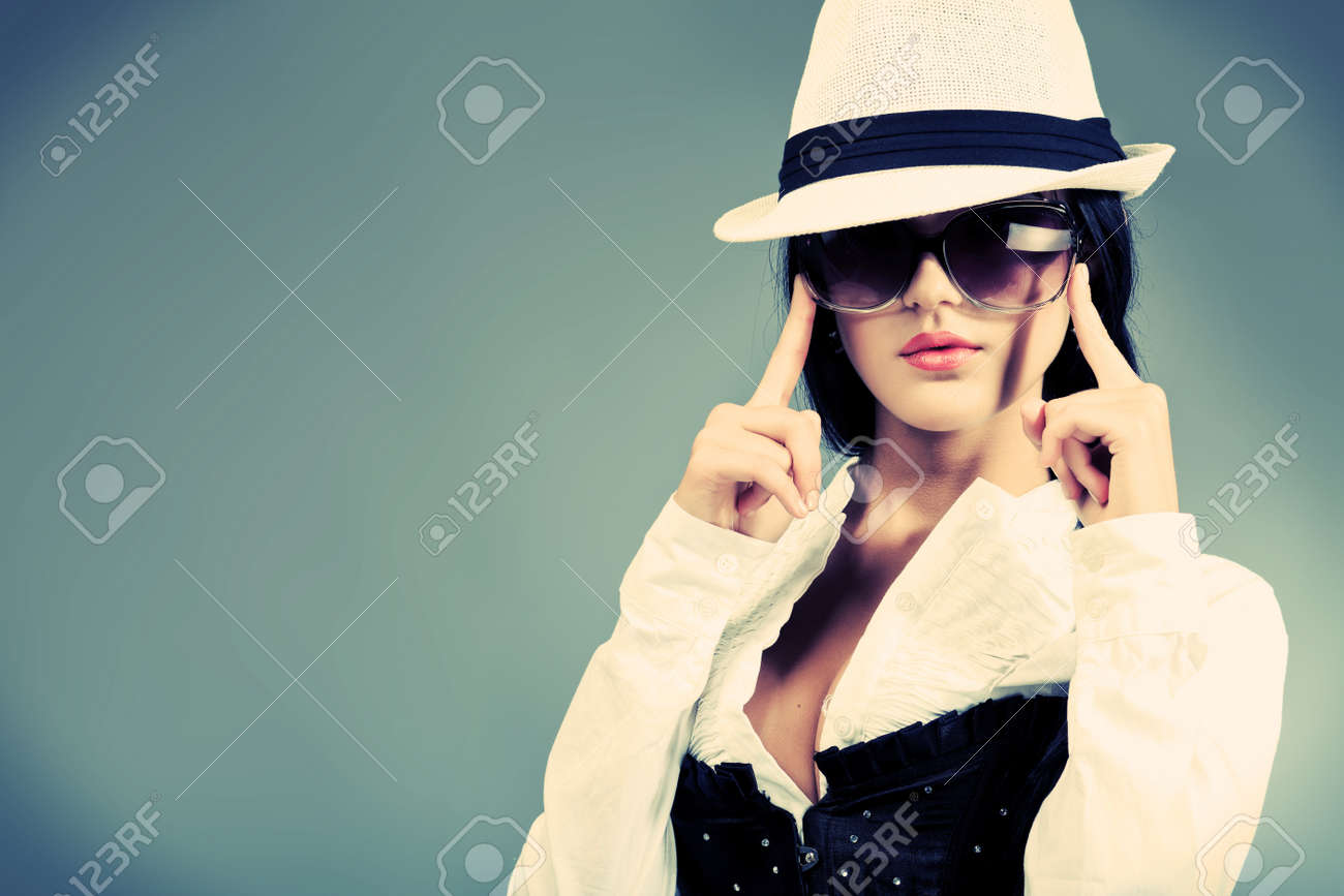 Fashion photo, a model is posing over grey background Stock Photo - 10488908