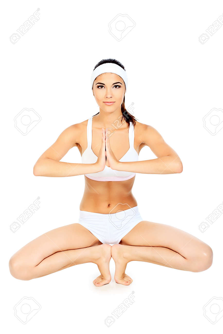 Shot of a sporty young woman doing yoga exercise. Isolated over white background. Stock Photo - 10564109