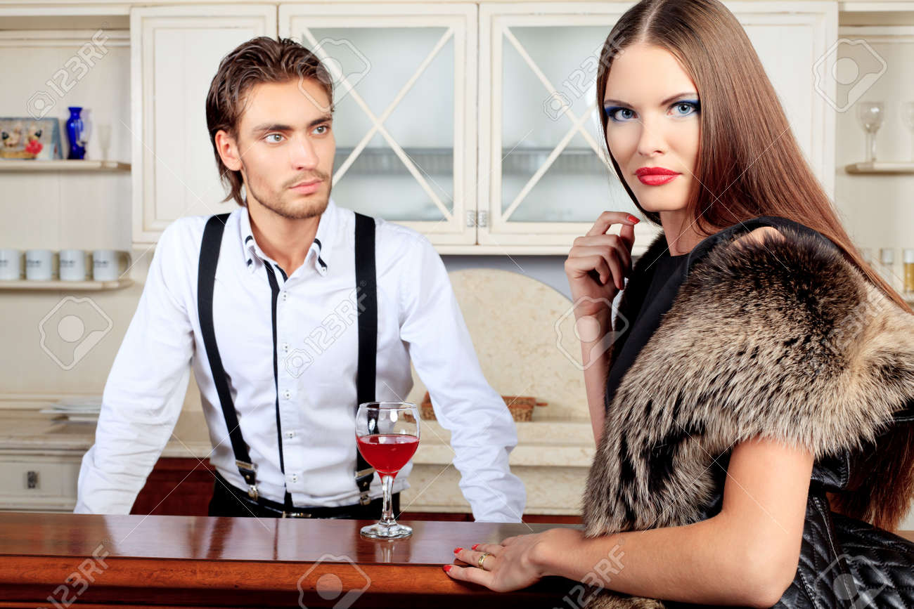 Portrait of a handsome fashionable man with  charming woman posing in the interior. Stock Photo - 10598030