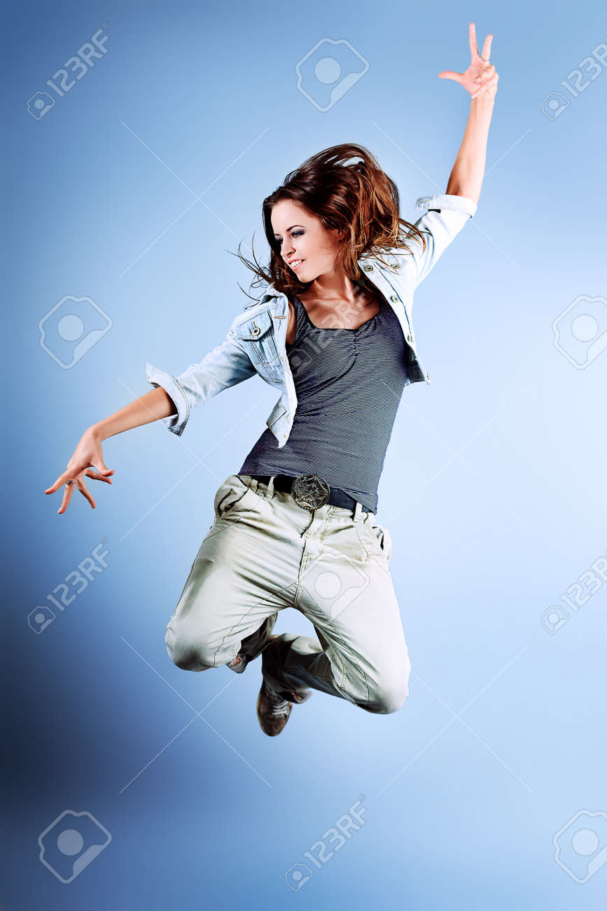 A couple of young man and woman dancing hip-hop at studio. Stock Photo - 10922755