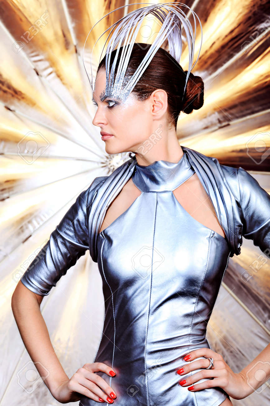 Fashion shot of a beautiful young woman in futuristic costume. Stock Photo - 11044284