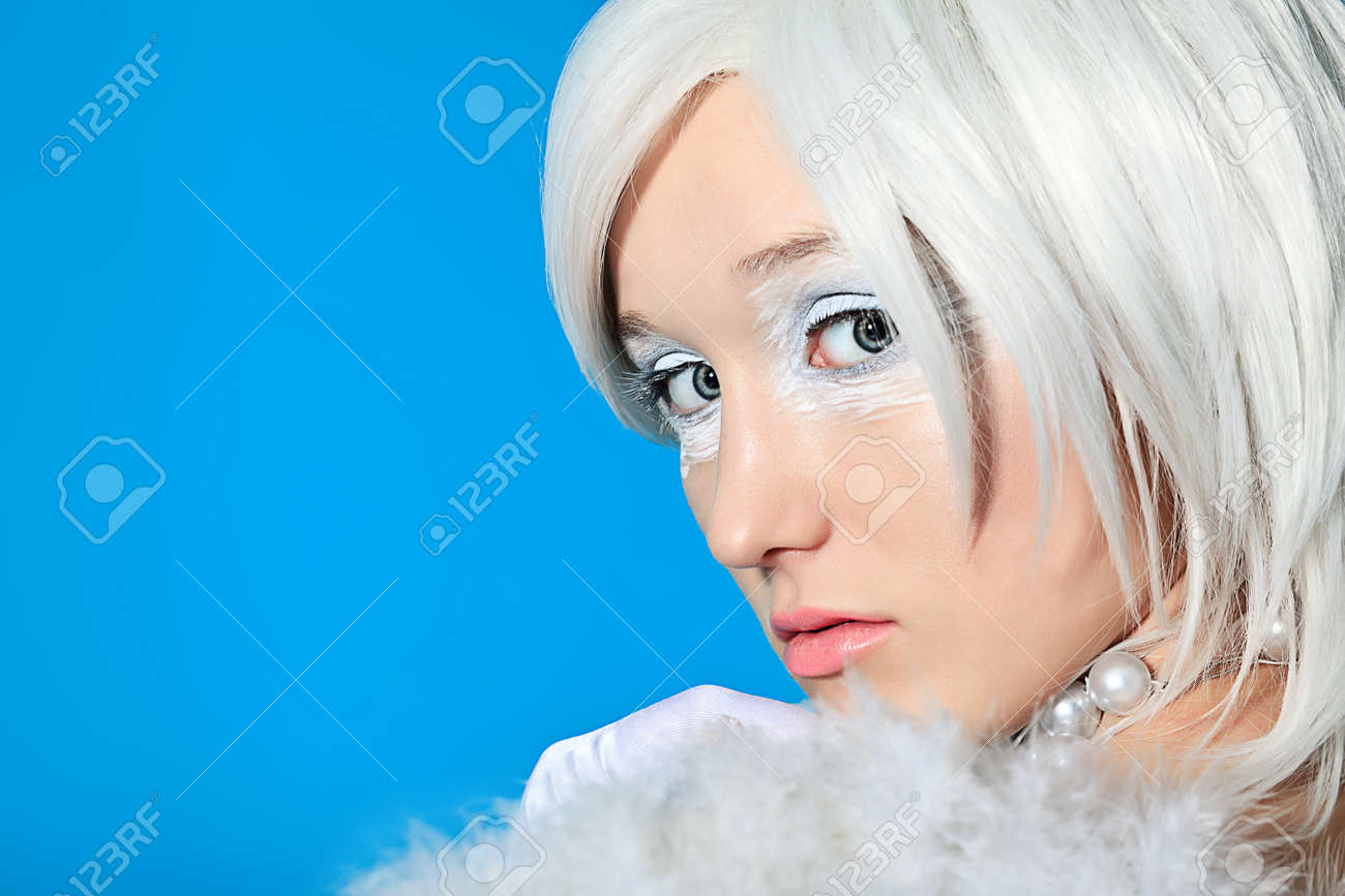 Portrait of an extravagant blonde model over blue background. Stock Photo - 11185228