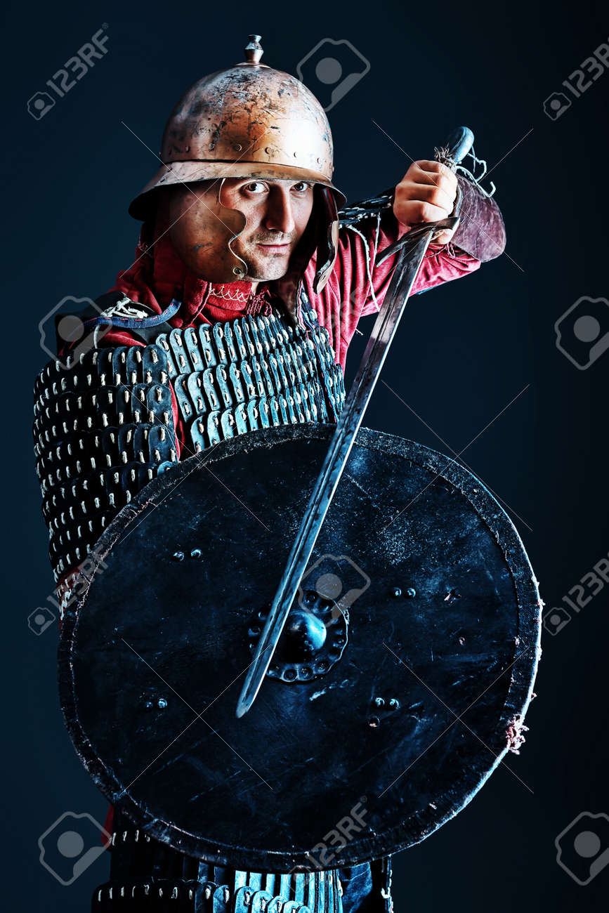 Portrait of a medieval male knight in armor over black background. Stock Photo - 11185160