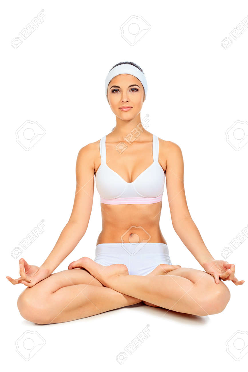Shot of a sporty young woman doing yoga exercise. Isolated over white background. Stock Photo - 11261611