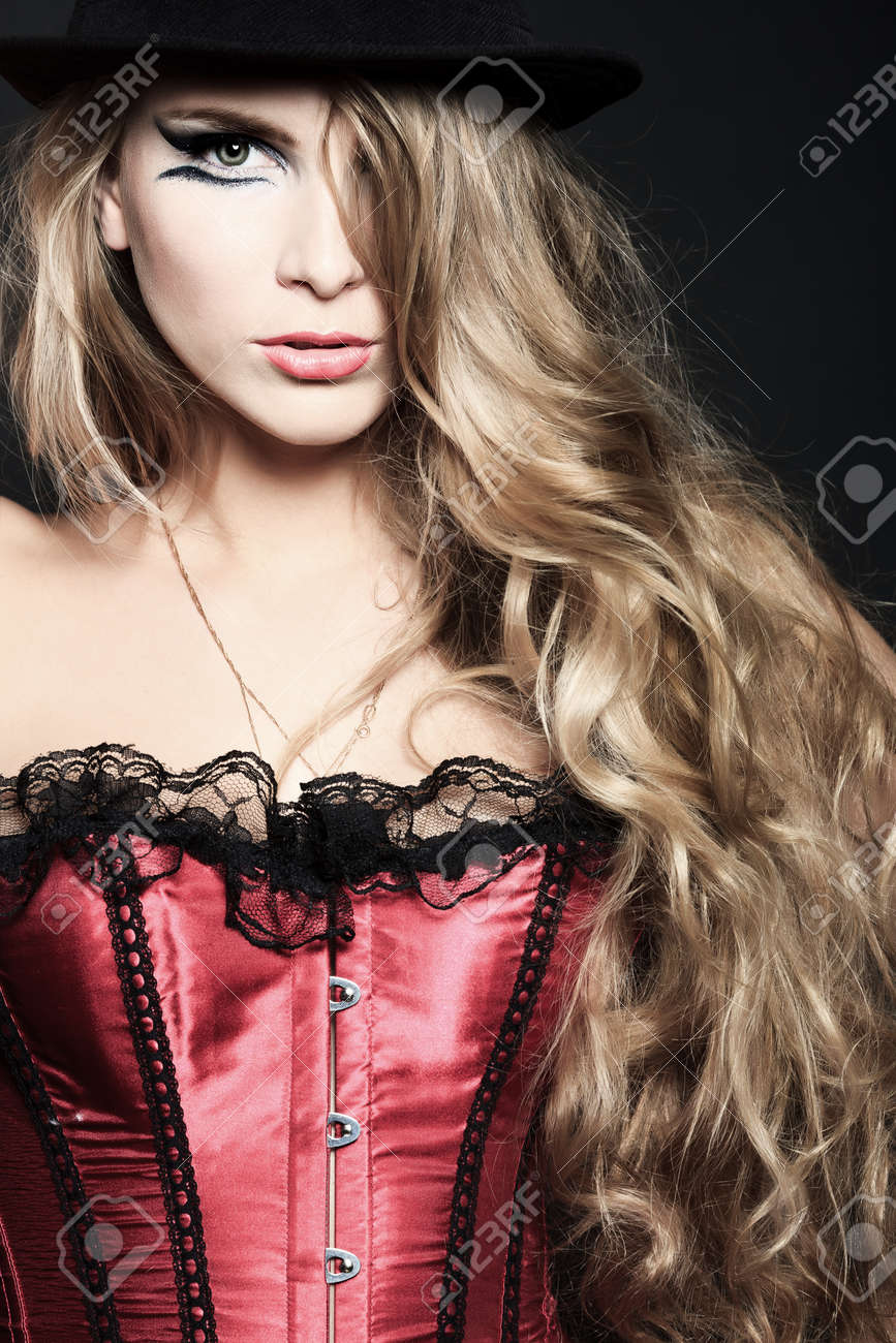 Portrait of a beautiful woman over black background. Stock Photo - 11340528