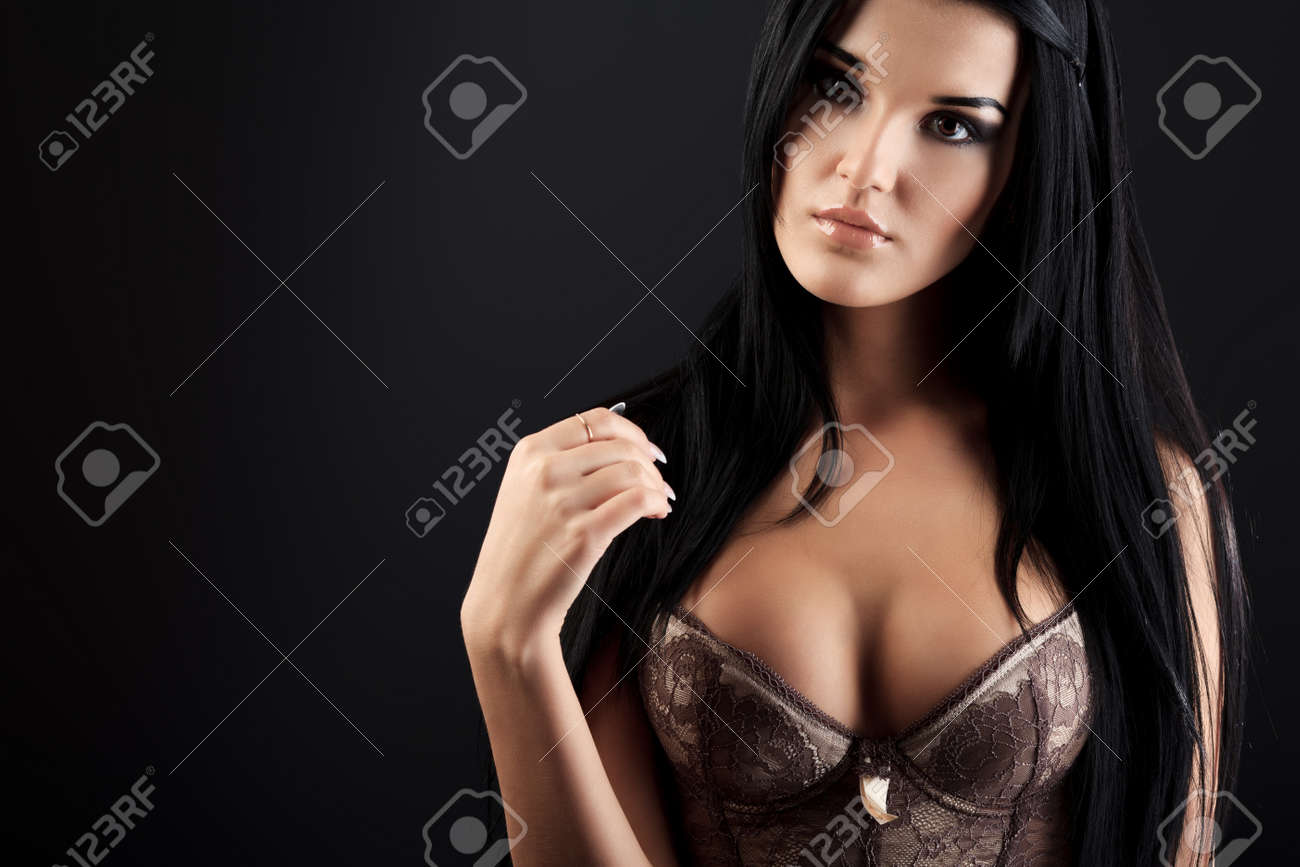 Shot of an attractive young woman in sexual lingerie, over black background Stock Photo - 13450973
