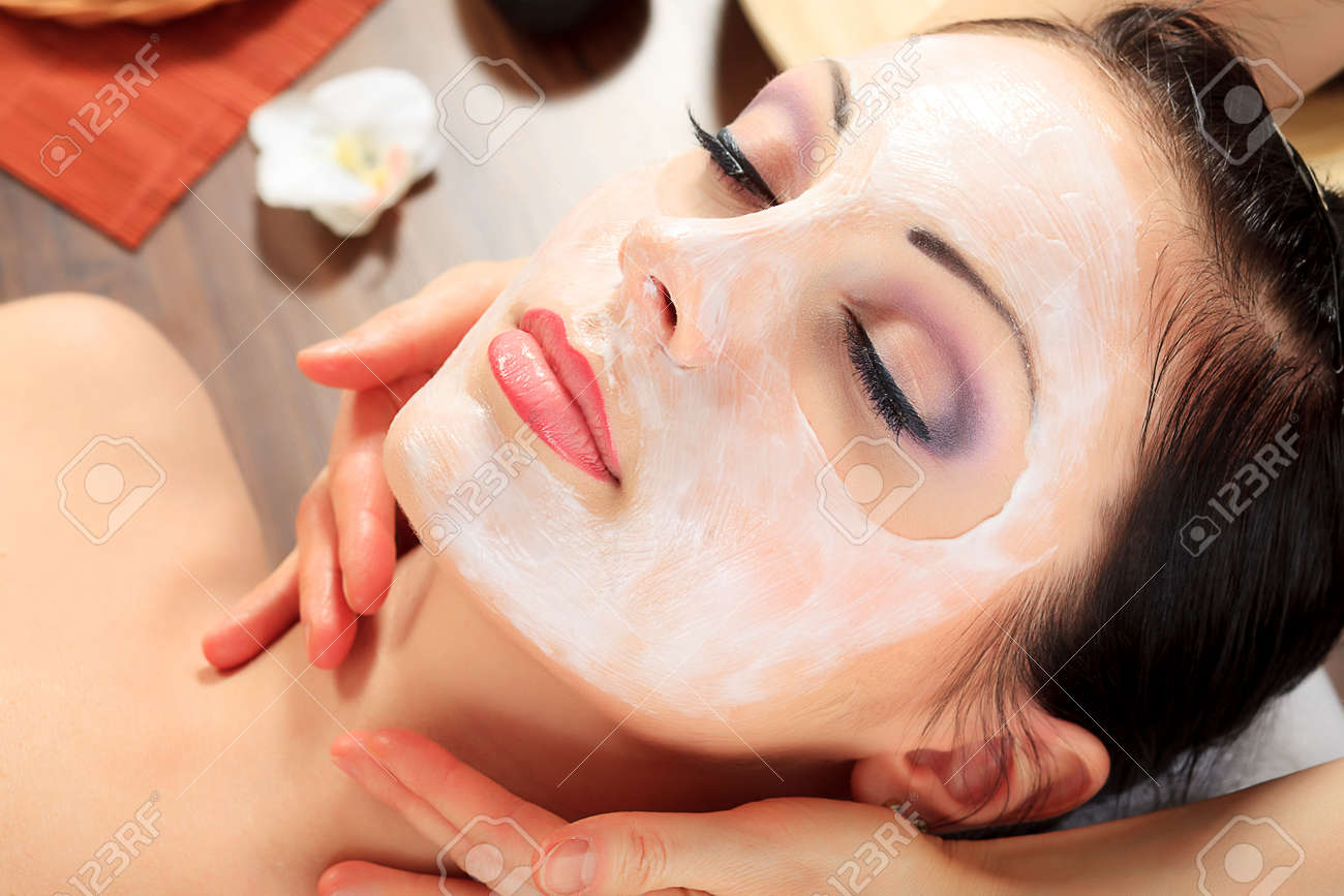 Portrait of a woman with spa mask on her face. Healthcare, medicine. Stock Photo - 12351574