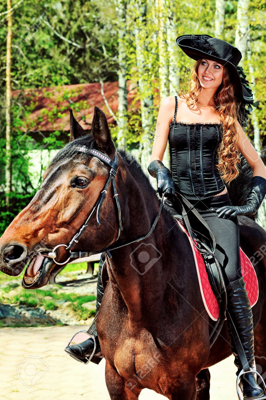 Beautiful Young Woman In Medieval Costume Is Riding On Horseback Stock Photo Picture And Royalty Free Image Image 12521680