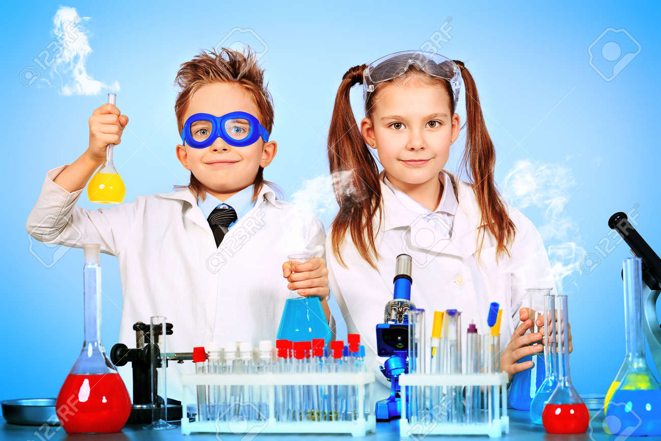 Two children making science experiments. Education. - 12658902