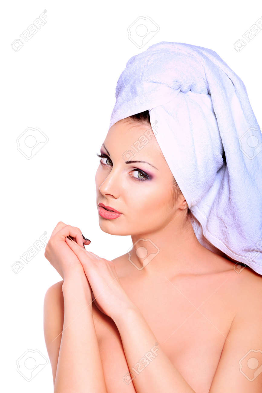 Beautiful young woman posing in white towel. Spa, healthcare. Isolated over white. Stock Photo - 12845385