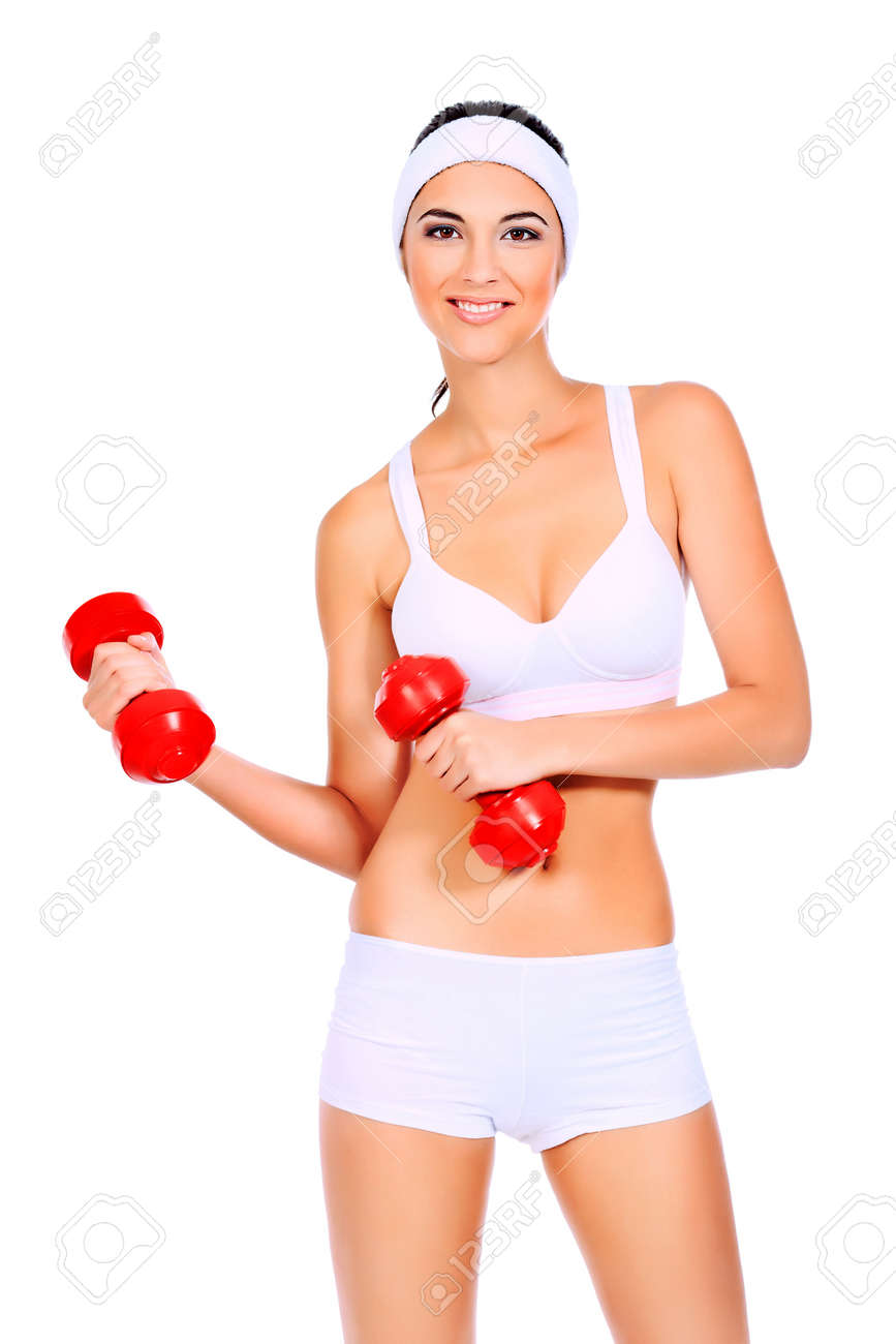 Shot of a sporty young woman with dumbbells. Active sporty life, wellness. Stock Photo - 13490187