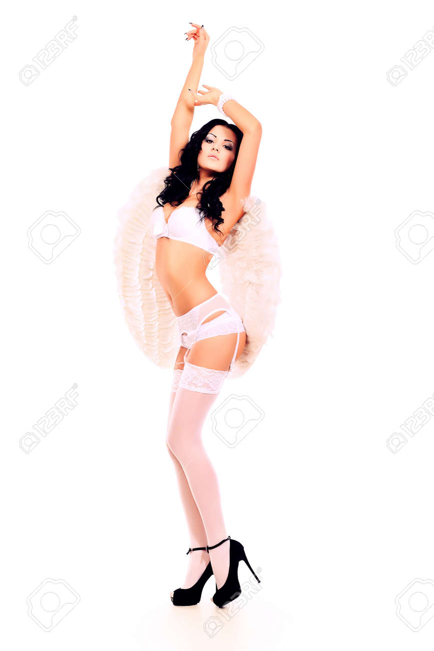 Portrait of a sexual young woman angel. Isolated over white background. Stock Photo - 13562651