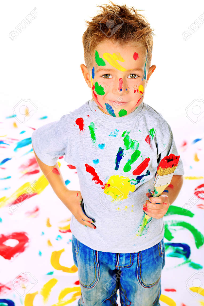 Portrait of a little boy enjoying his painting. Education. Stock Photo - 13712186