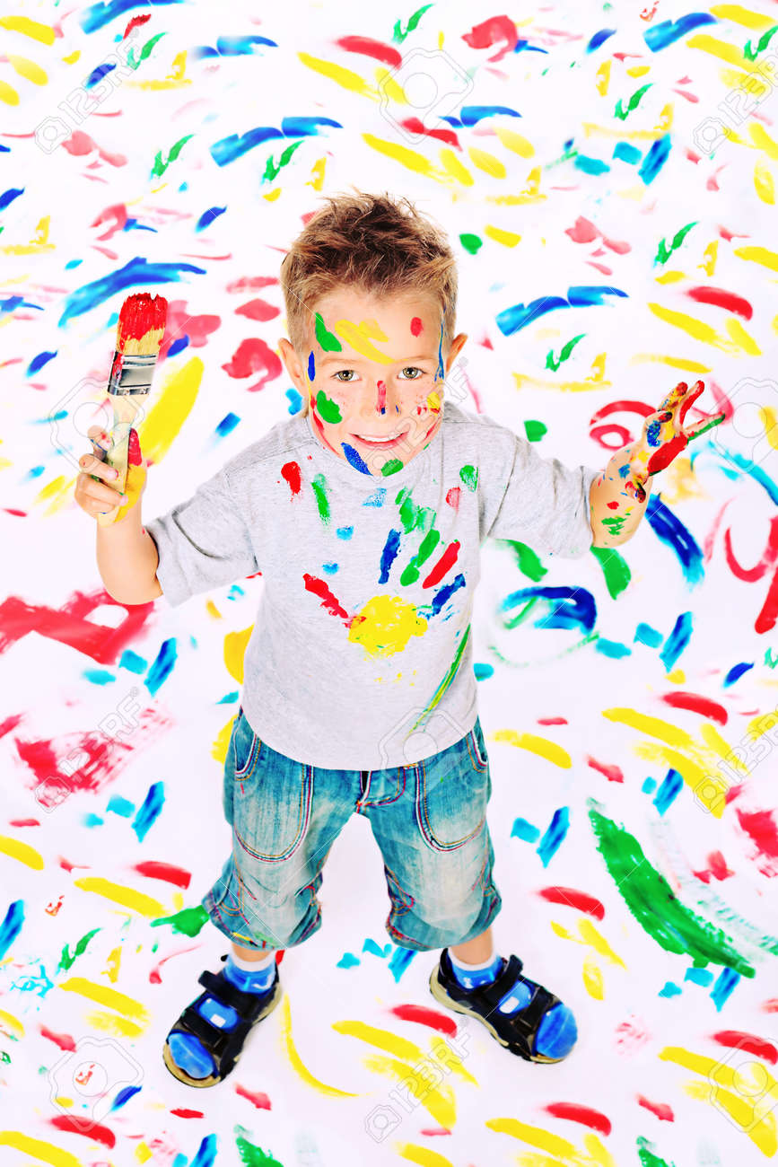 Portrait of a little boy enjoying his painting. Education. Stock Photo - 13712244
