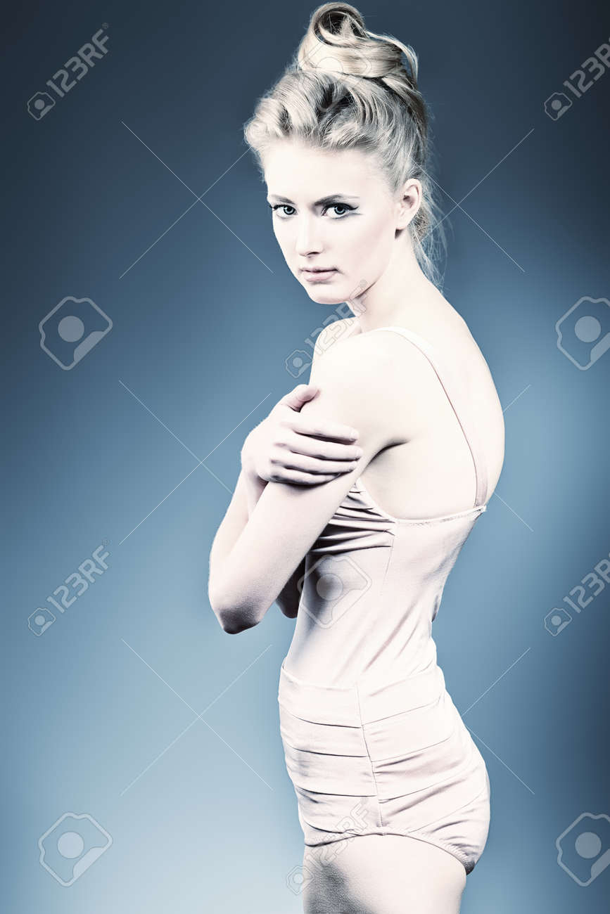 Beautiful ballet dancer posing at studio. Stock Photo - 13831924