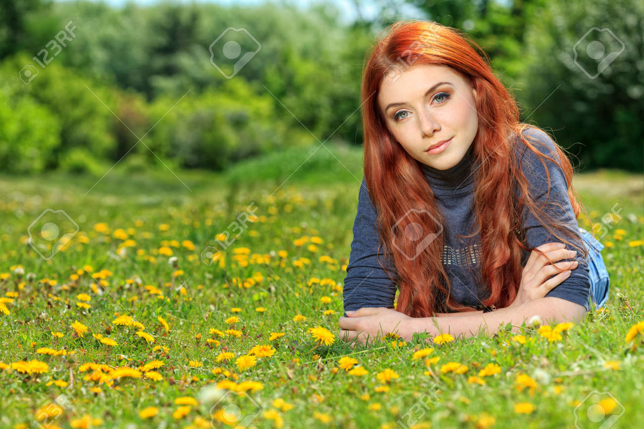 Romantic young woman outdoors at a summer day. - 13890665