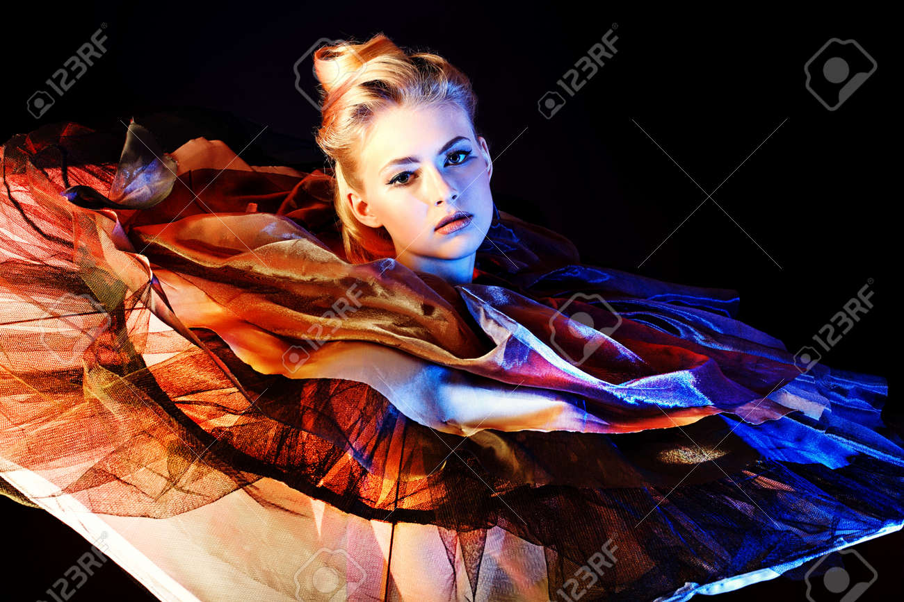 Art fashion photo of a beautiful model. Over black background. Stock Photo - 14473921