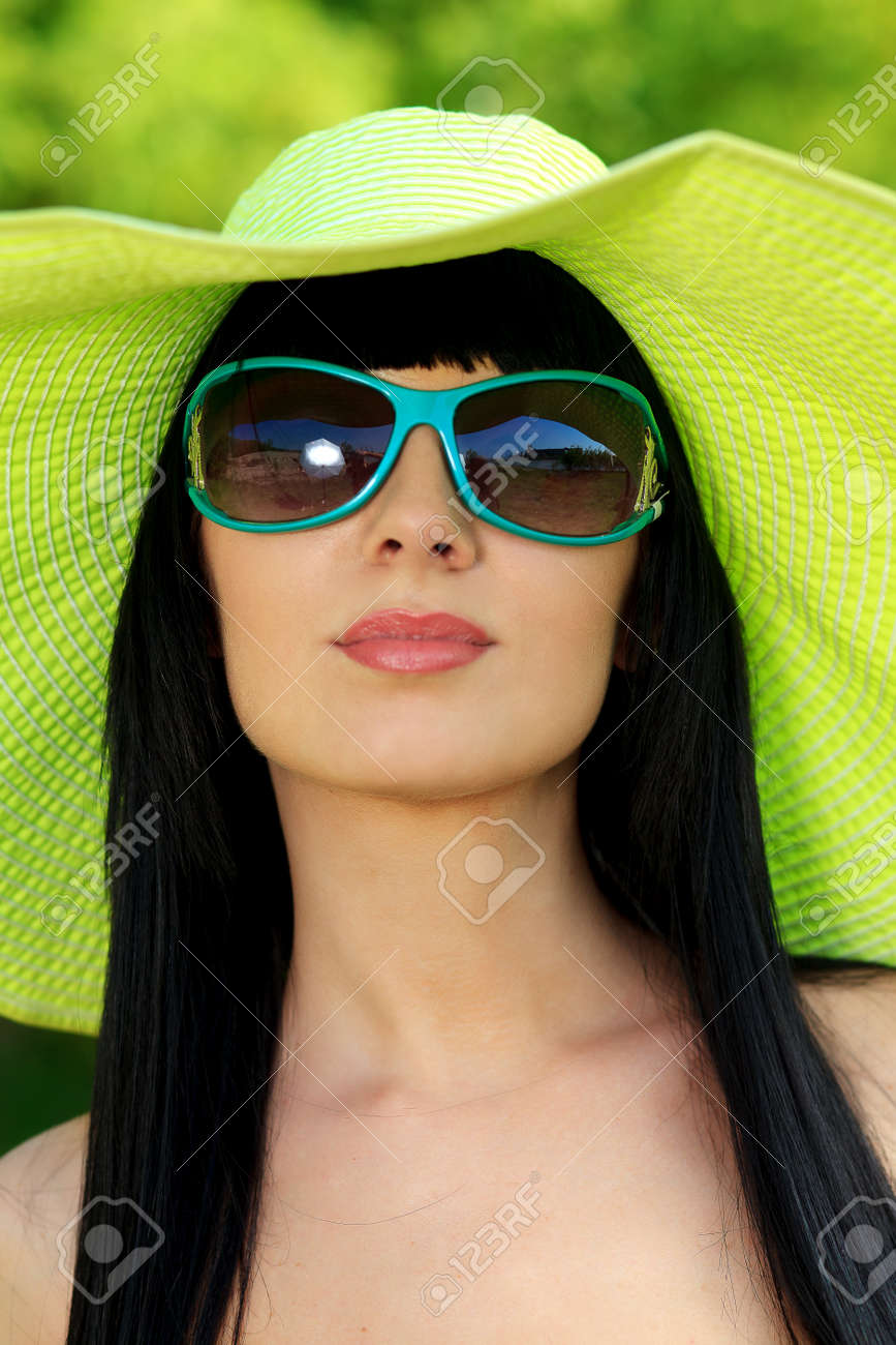 d8c248ed8e Portrait of a beautiful young woman in sunglasses posing outdoor. Stock  Photo - 14517833