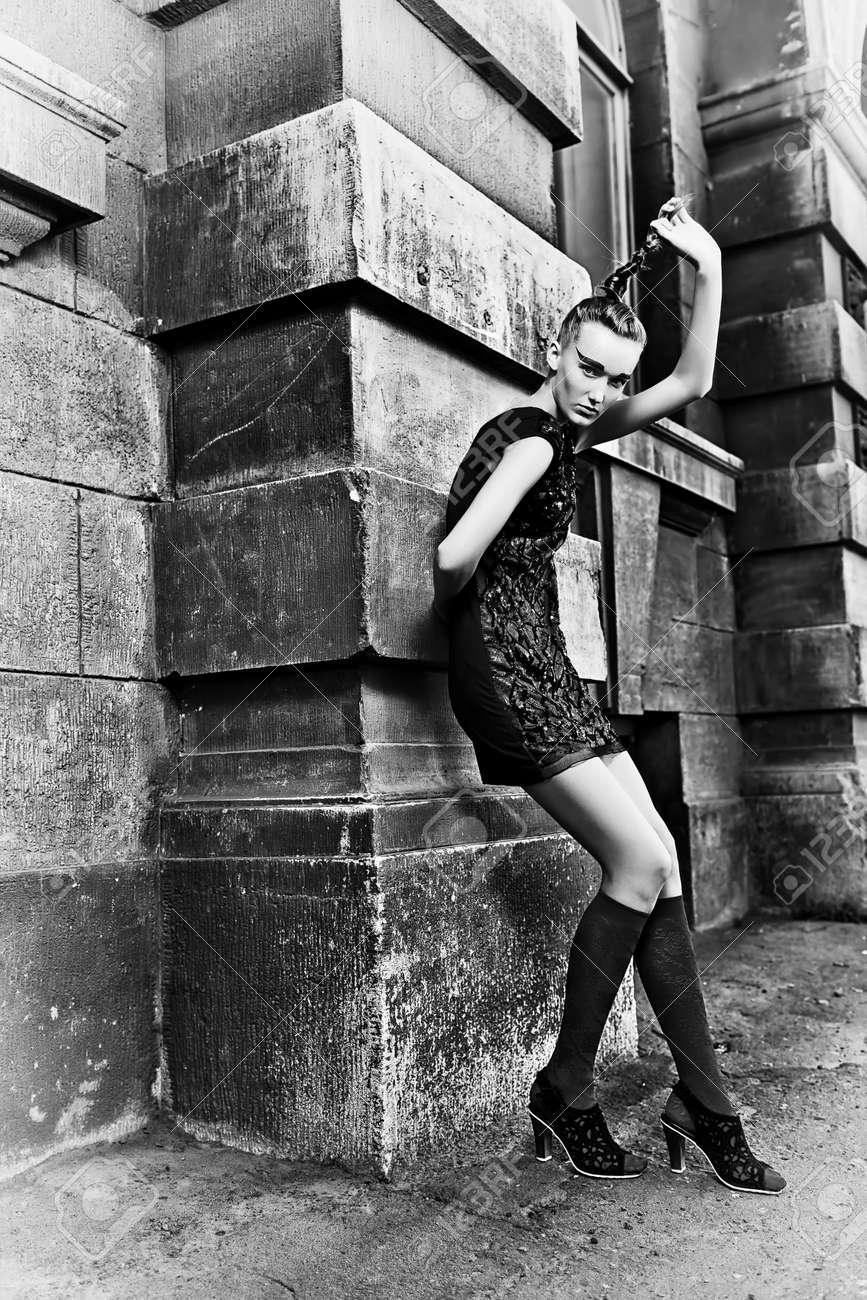 Fashion woman posing on a city street. Stock Photo - 14551466