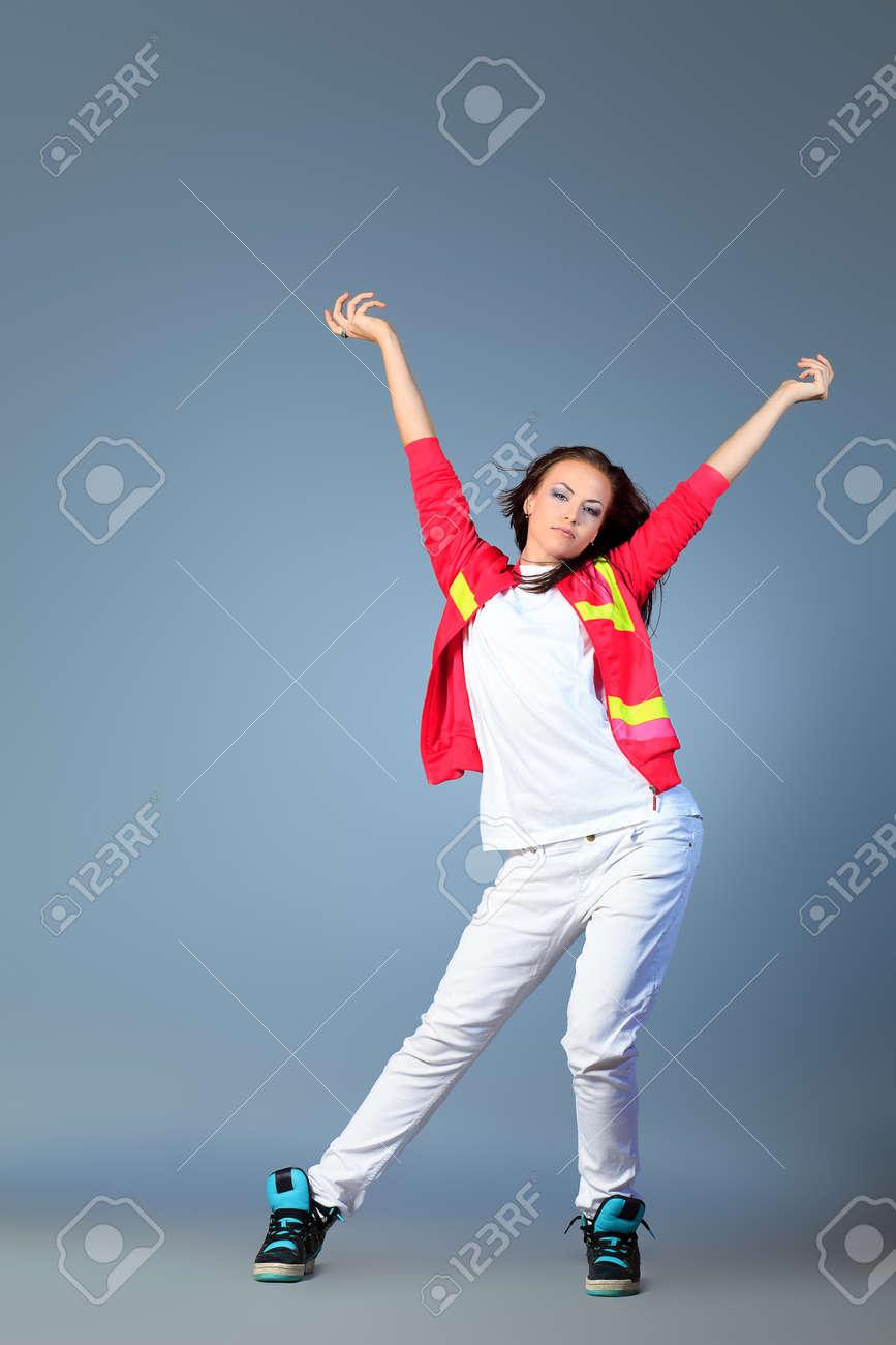 Modern girl dancing hip-hop at studio. Stock Photo - 14693683