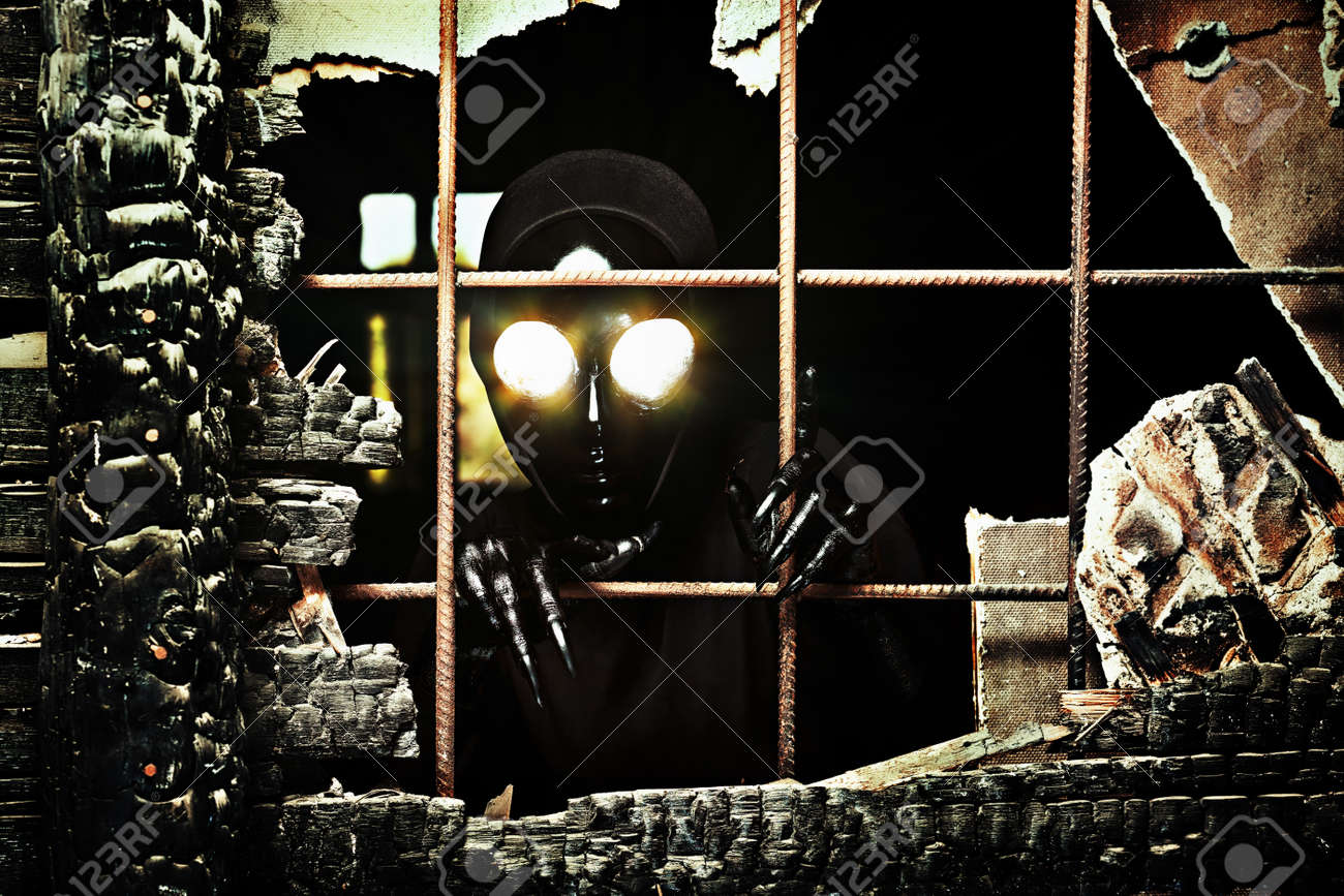 Scary alien creature in an abandoned house. Halloween, horror. Stock Photo - 14954398