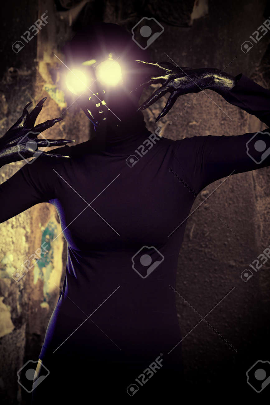 Scary alien creature in an abandoned house. Halloween, horror. Stock Photo - 15056712