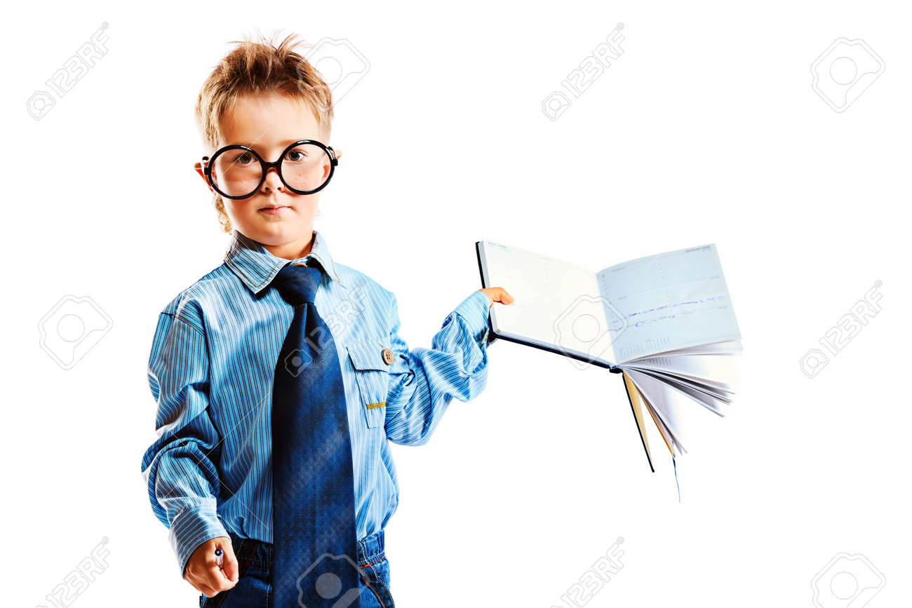 Little boy in spectacles and suit standing with opened diary. Isolated over white background. Stock Photo - 15236928
