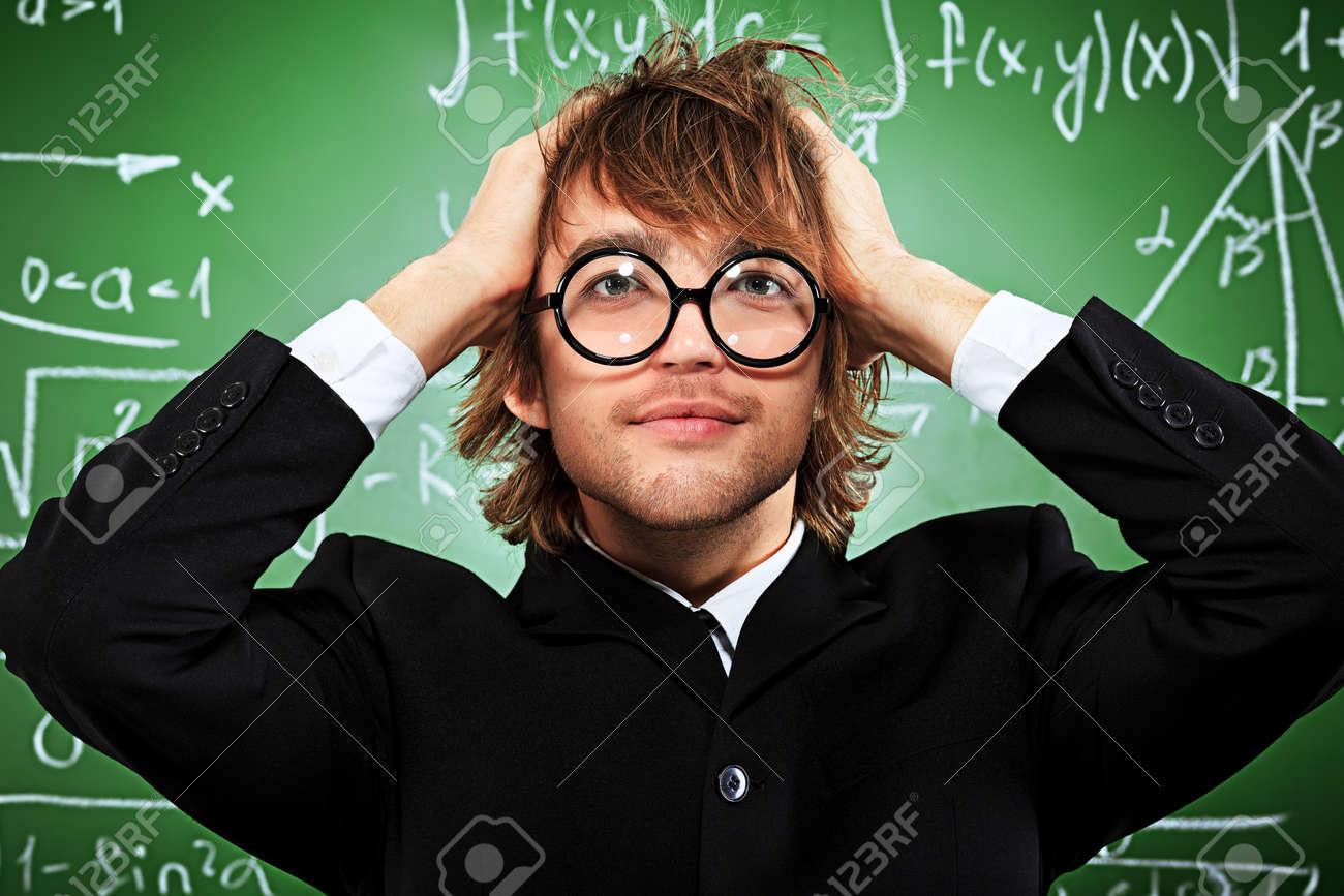 Portrait of a stressed male student near the blackboard. Stock Photo - 15771177
