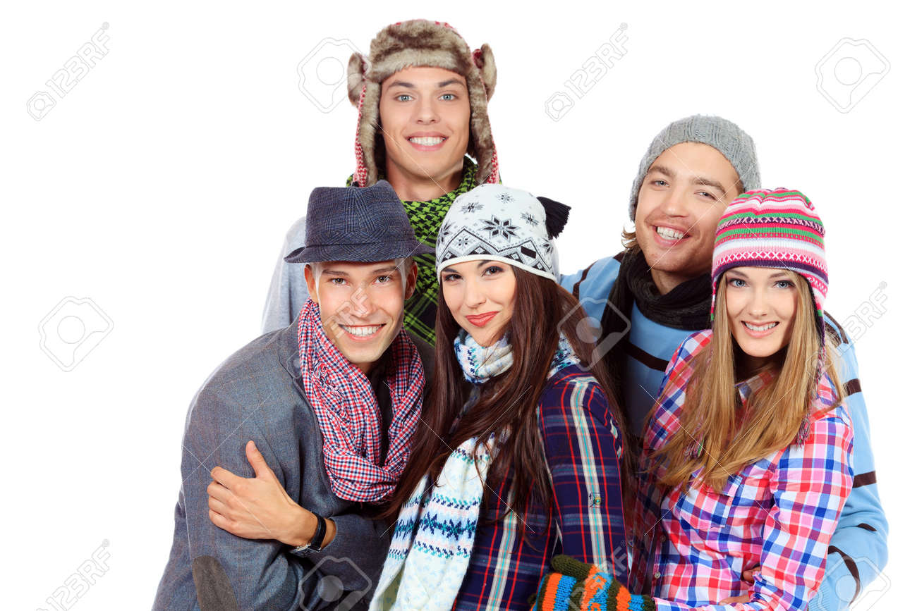 Group Of Cheerful Young People In Warm Clothes Standing Together ...