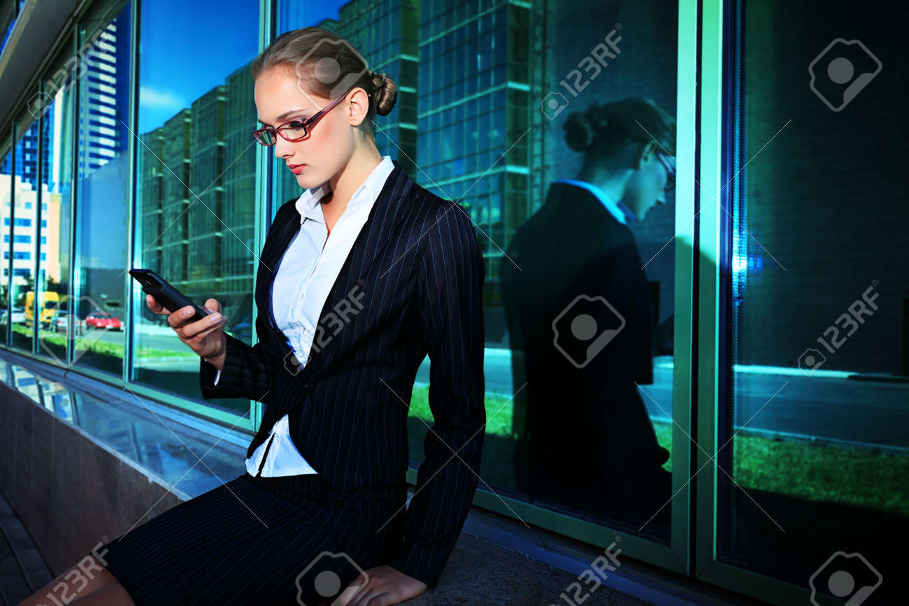 Young business woman talking on her mobile phone in the big city. Stock Photo - 16551726