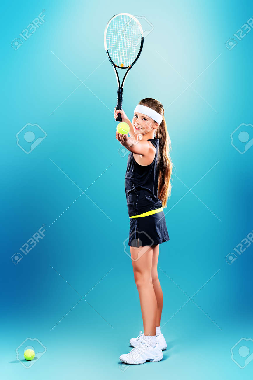 Portrait of a girl tennis player holding tennis racket and tennis ball. Studio shot. Stock Photo - 16606706