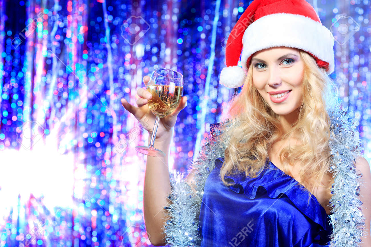 Pretty teenage girl in Christmas clothes on a party. Disco lights in the background. Stock Photo - 16663259