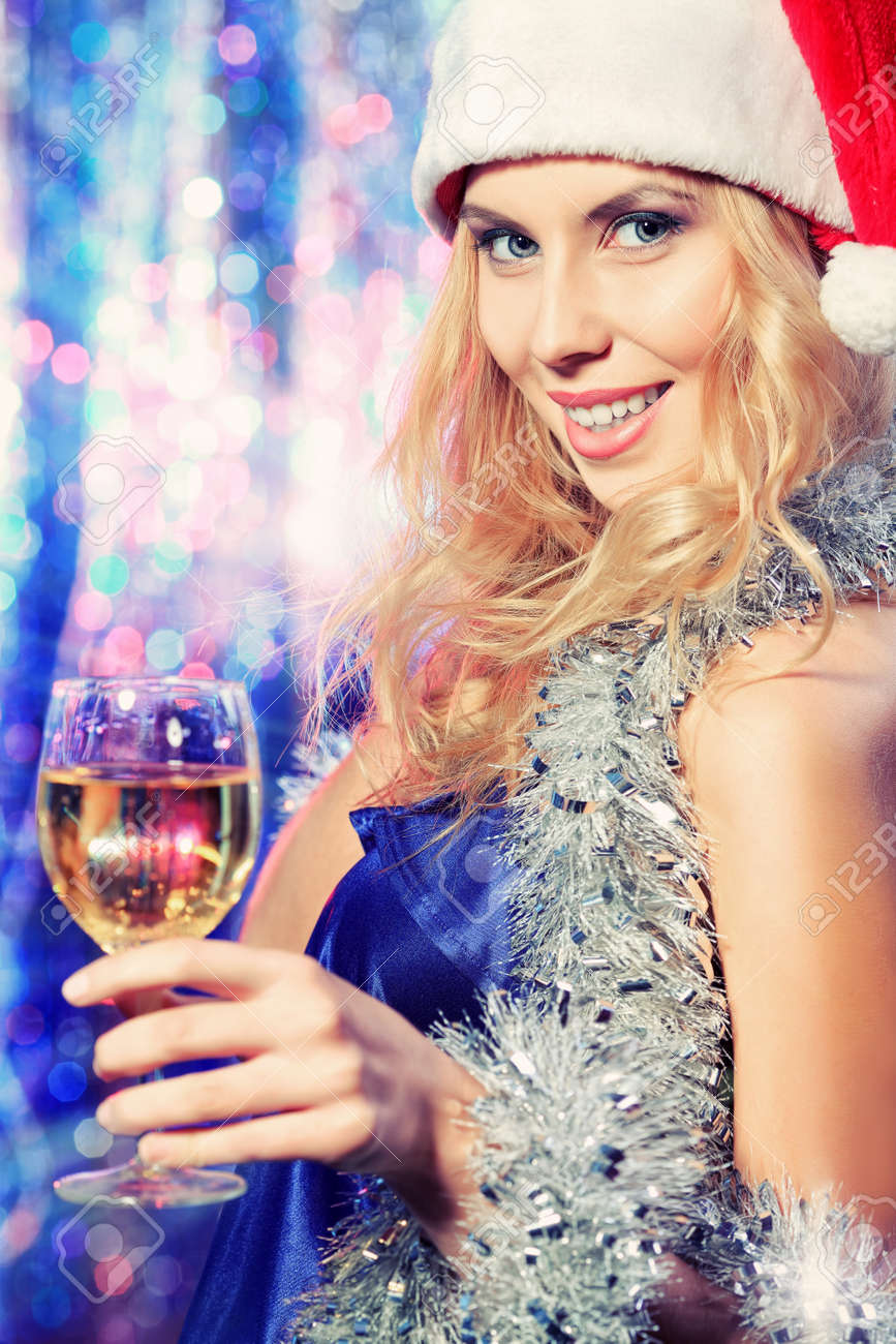 Pretty teenage girl in Christmas clothes on a party. Disco lights in the background. Stock Photo - 16663256