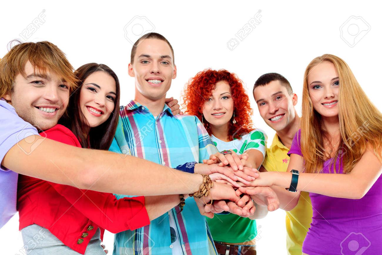 Un Gran Grupo De Jovenes Tomados De La Mano Amistad Aislado En Blanco Fotos Retratos Imagenes Y Fotografia De Archivo Libres De Derecho Image 16671869