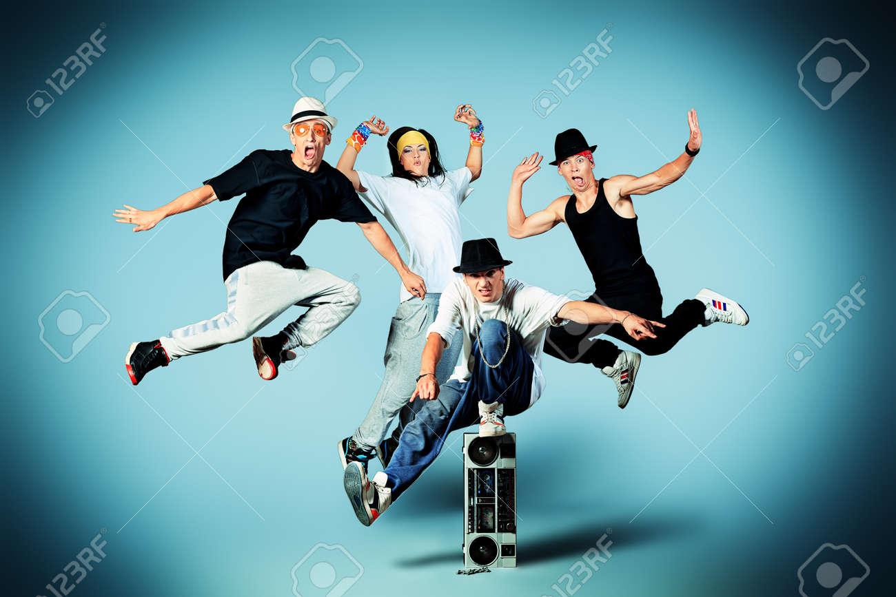 Group of modern dancers dancing hip-hop at studio. - 16859608