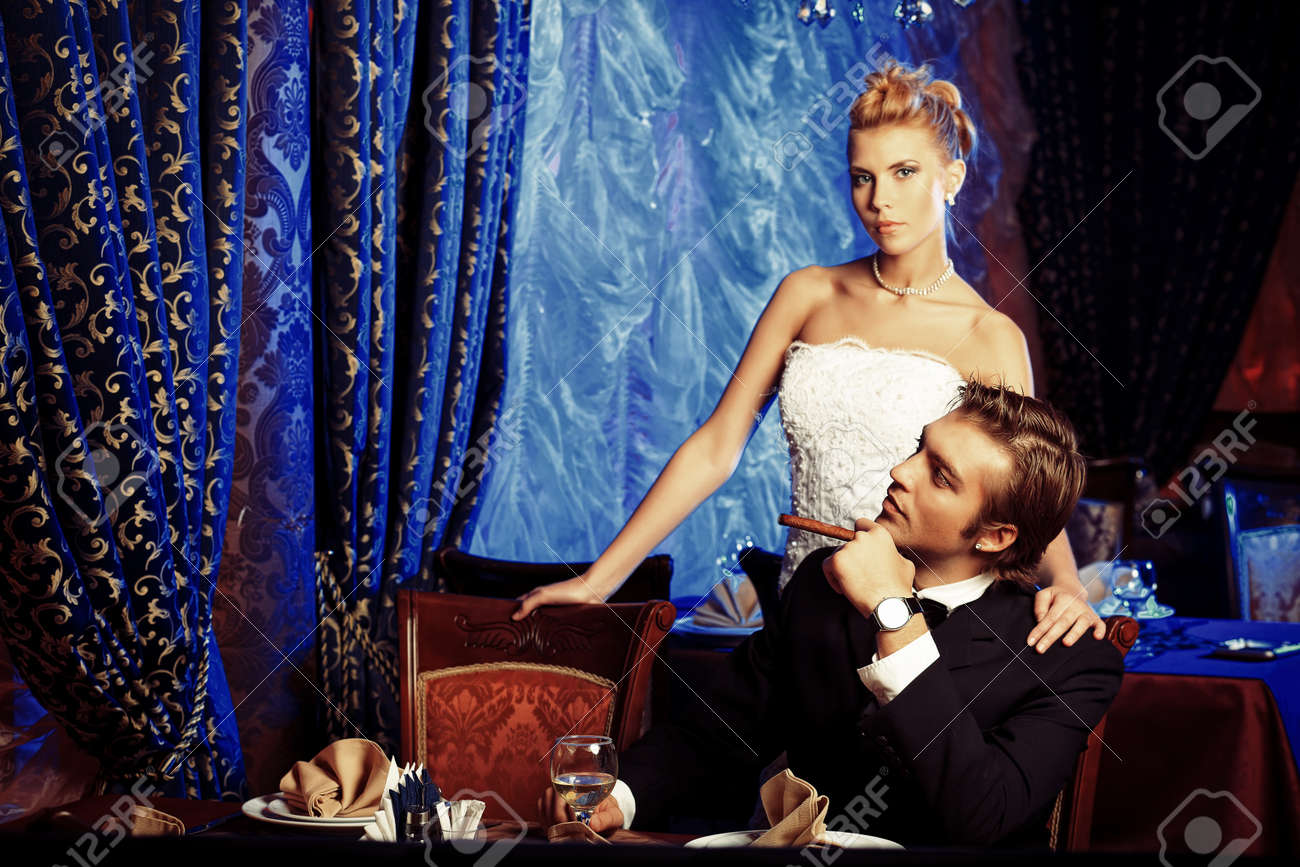 Charming bride and groom on their wedding celebration in a luxurious restaurant. Stock Photo - 16890548