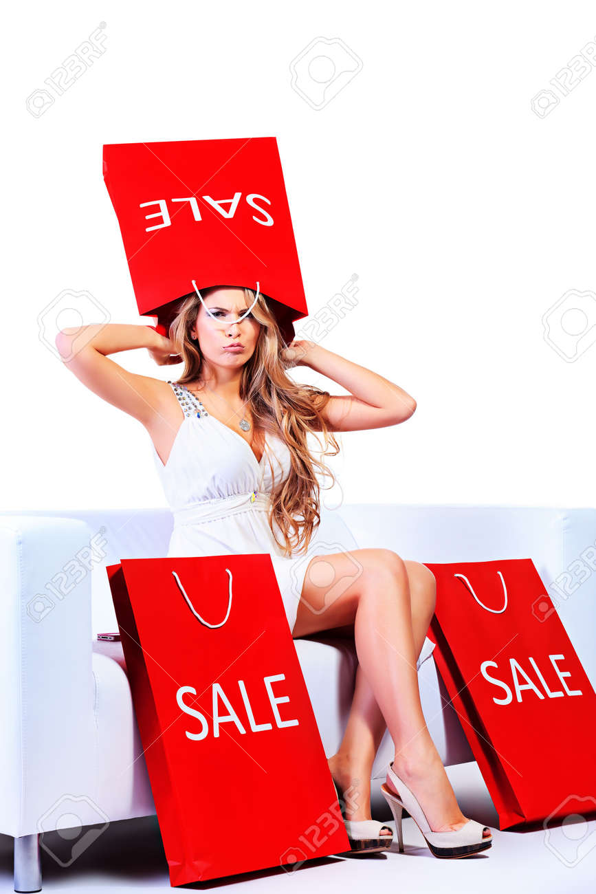Happy blonde woman enjoying her shopping with shopping bags. Isolated over white. Stock Photo - 17134106