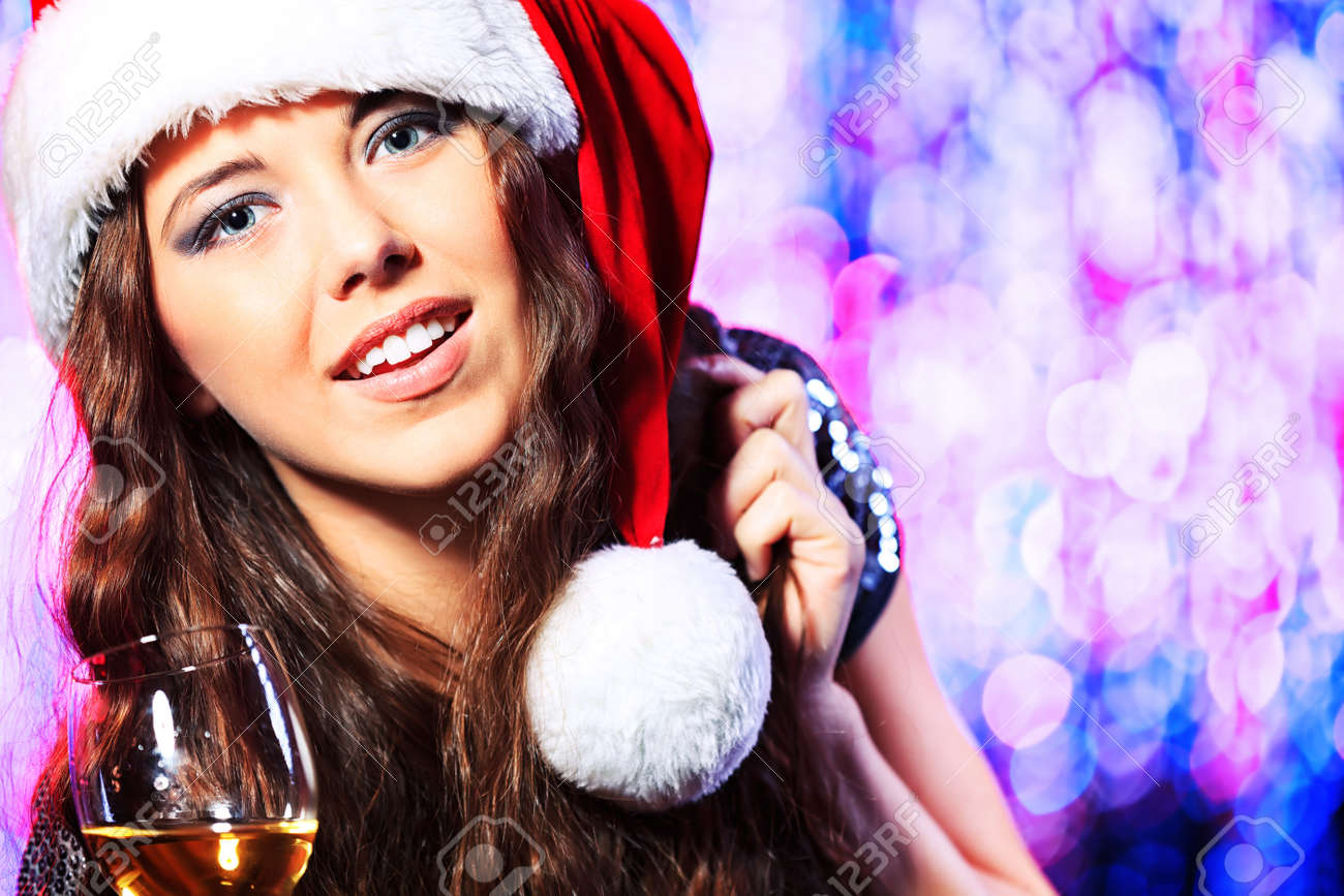 Pretty teenage girl in Christmas clothes on a party. Disco lights in the background. Stock Photo - 17234879