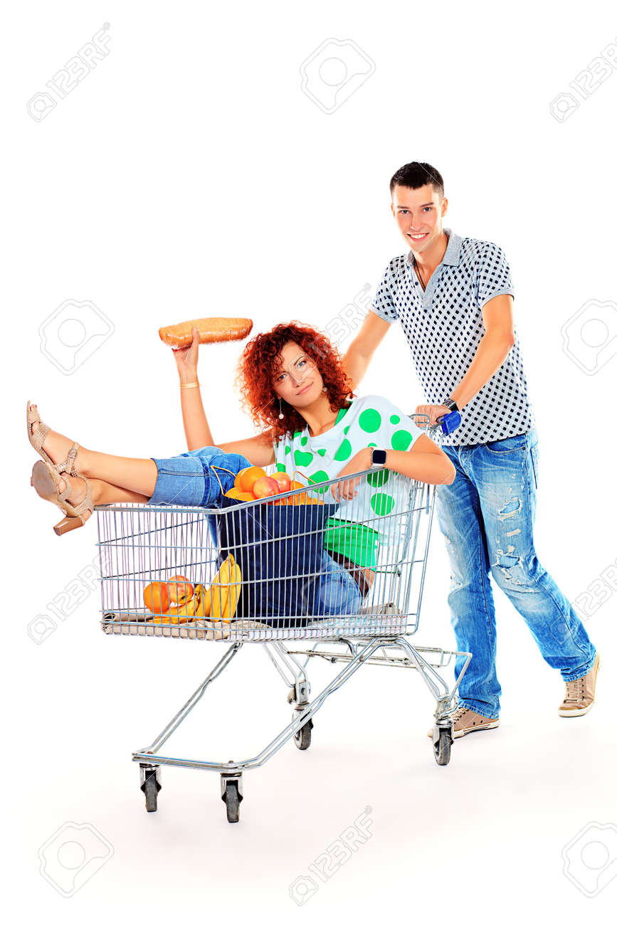Cheerful couple with a shopping trolley. Isolated over white background. Stock Photo - 18207168