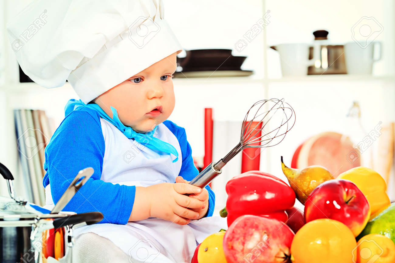 67d0f102a Cute small baby in the cook costume at the kitchen. Stock Photo - 18230473