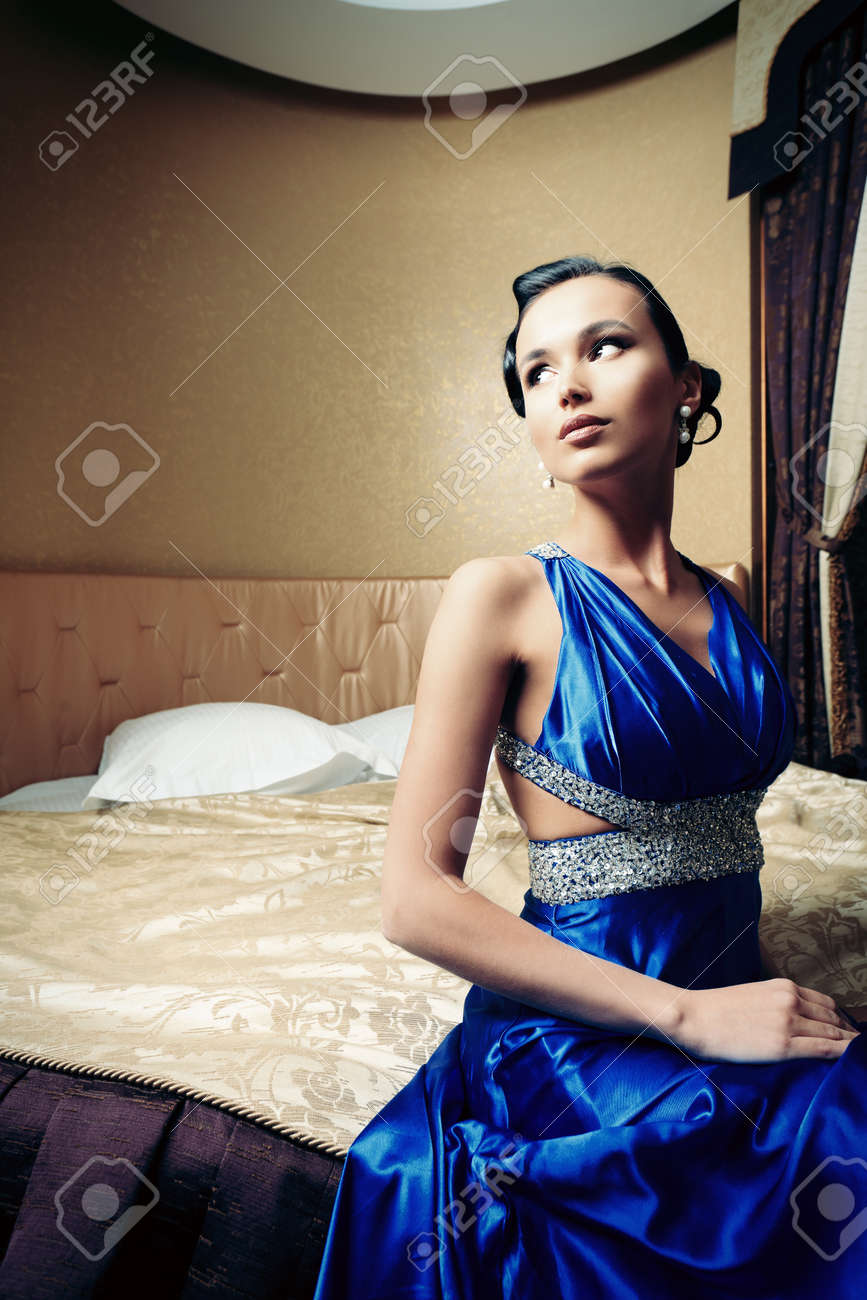 Beautiful young woman in a  luxurious classic interior. Stock Photo - 19381094
