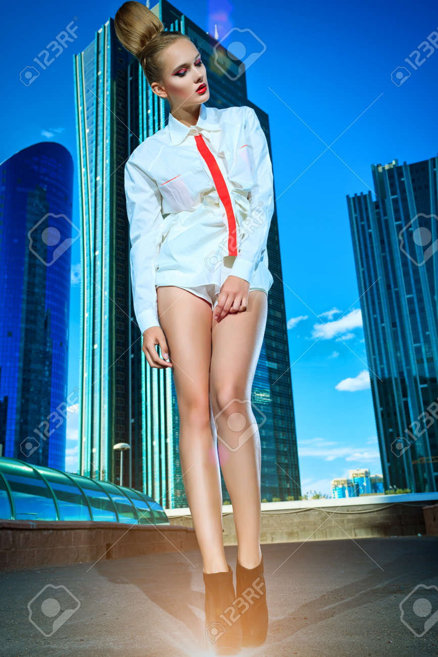 Full length portrait of a fashion model posing over big city background. Stock Photo - 19562158