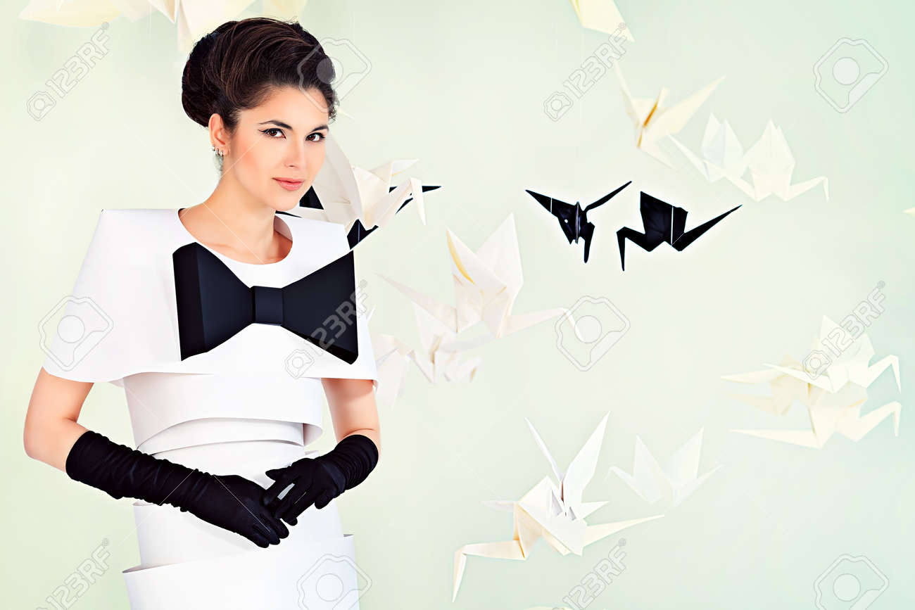 Art fashion photo of a gorgeous woman in paper dress. Black and white. Stock Photo - 20633757