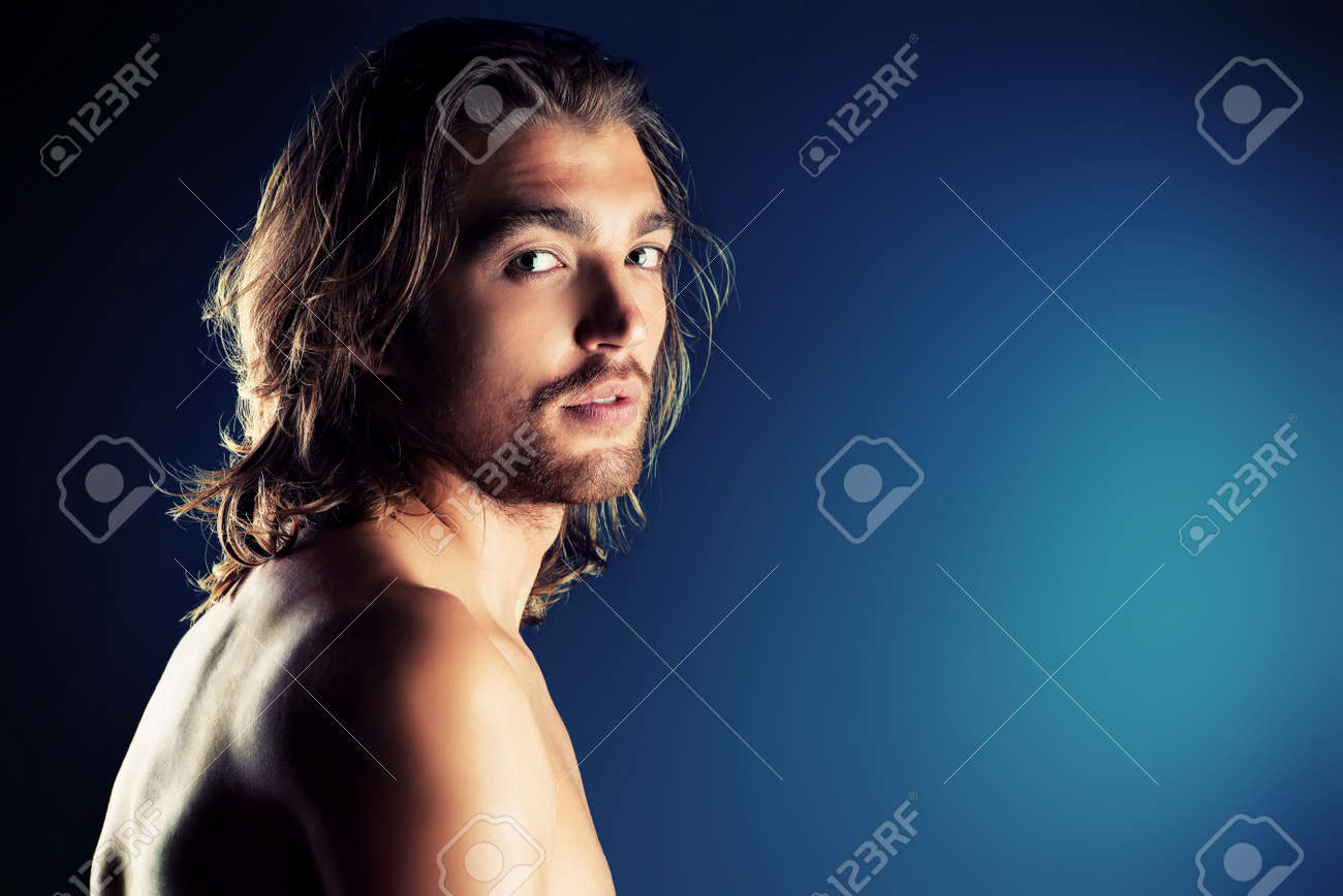 Portrait of a sexual muscular man posing over dark background. Stock Photo - 20727459