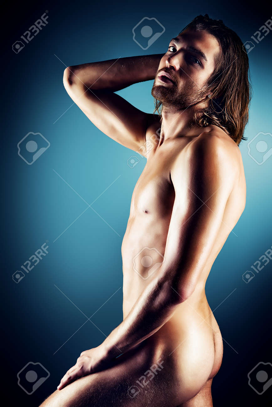 Sexual muscular nude man posing over dark background. Stock Photo - 21363460