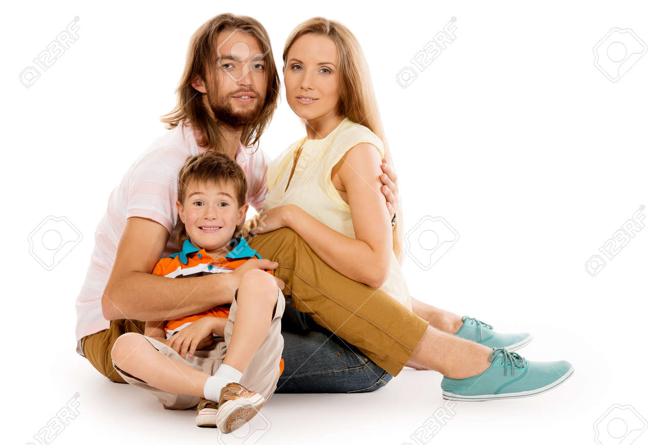 Portrait of a happy family. Father, mother and son. Isolated over white. Stock Photo - 22101359
