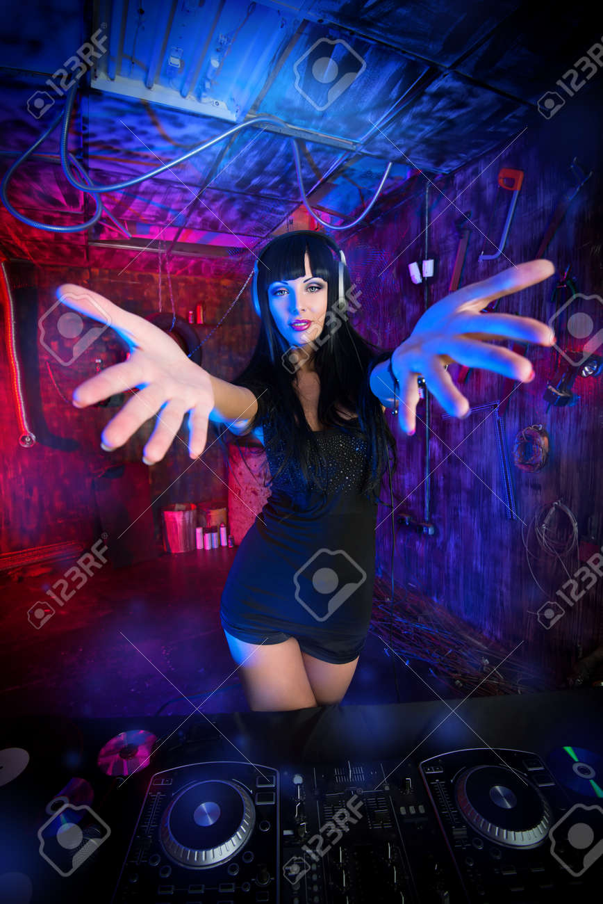 Beautiful sexual DJ girl working on a party in the old garage. Stock Photo - 22710703