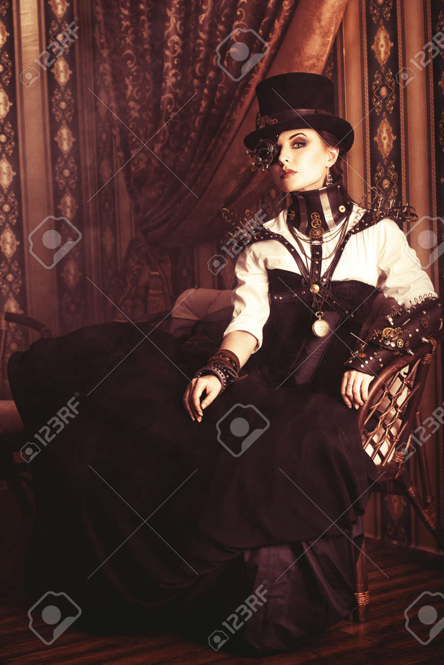 Full length portrait of a beautiful steampunk woman over vintage background. Stock Photo - 23199782